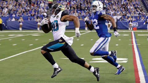 Jacksonville Jaguars running back Corey Grant (30 outruns Indianapolis Colts safety T.J. Green (32) to the end zone for a touchdown during the first half of an NFL football game in Indianapolis, Sunday, Jan. 1, 2017. (AP Photo/Darron Cummings)
