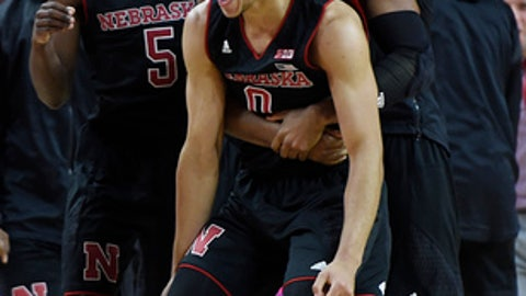 Nebraska's Tai Webster, right, and Glynn Watson, along with the rest of the team, celebrate their victory over Maryland in an NCAA college basketball game, Sunday, Jan. 1, 2017, in College Park, Md. (AP Photo/Gail Burton)