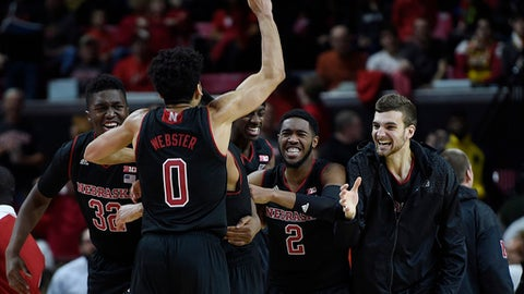 Nebraska's Tai Webster,(0), Jeah Horne, (32), Jordy Tshimanga, (2) celebrate their victory over Maryland in an NCAA college basketball game, Sunday, Jan. 1, 2017, in College Park, Md. (AP Photo/Gail Burton)