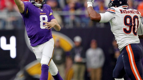 Minnesota Vikings quarterback Sam Bradford (8) throws a pass over Chicago Bears defensive end Cornelius Washington, right, during the first half of an NFL football game Sunday, Jan. 1, 2017, in Minneapolis. (AP Photo/Andy Clayton-King)