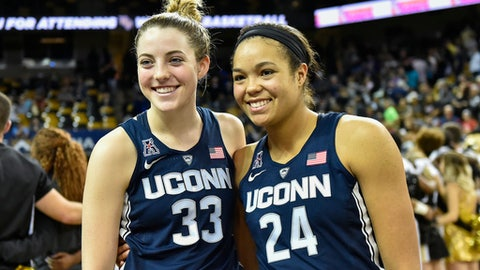 Connecticut's Katie Lou Samuelson (33) and forward Napheesa Collier (24) wait to speak to the media following an NCAA college basketball game, Sunday, Jan. 1, 2017, in Orlando, Fla. Connecticut defeated UCF 84-48. (AP Photo/Roy K. Miller)