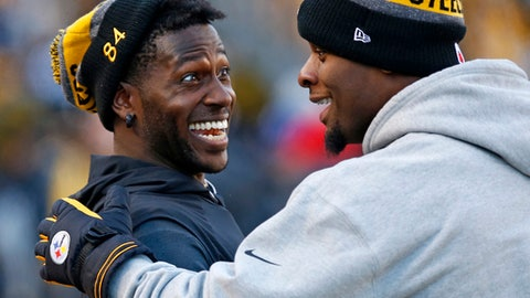 Pittsburgh Steelers wide receiver Antonio Brown, left, and running back Le'Veon Bell celebrate on the sideline after a Steelers touchdown during the second half of an NFL football game against the Cleveland Browns in Pittsburgh, Sunday, Jan. 1, 2017. (AP Photo/Jared Wickerham)
