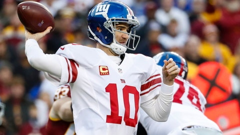 New York Giants quarterback Eli Manning (10) throws a pass during the first half of the team's NFL football game against the Washington Redskins in Landover, Md., Sunday, Jan. 1, 2017. (AP Photo/Alex Brandon)