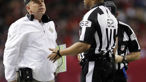New Orleans Saints head coach Sean Payton speaks with referee Ron Torbert (62) during the first half of an NFL football game against the Atlanta Falcons, Sunday, Jan. 1, 2017, in Atlanta. A touchdown catch made by New Orleans Saints tight end Coby Fleener was overruled by the officials and the New Orleans Saints kicked a field goal. (AP Photo/David Goldman)