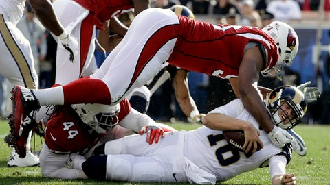 Los Angeles Rams quarterback Jared Goff, bottom right, is sacked by Arizona Cardinals outside linebacker Markus Golden (44) and defensive end Calais Campbell, top, during the first half of an NFL football game Sunday, Jan. 1, 2017, in Los Angeles. (AP Photo/Jae C. Hong)