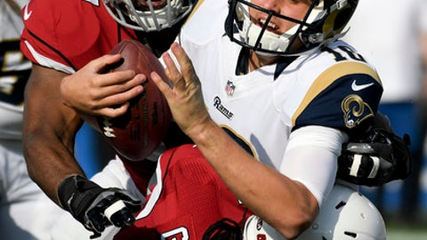 Los Angeles Rams quarterback Jared Goff (16) is sacked by Arizona Cardinals outside linebacker Markus Golden (44) and outside linebacker Alex Okafor (57) during the first half of an NFL football game Sunday, Jan. 1, 2017, in Los Angeles. (AP Photo/Mark J. Terrill)