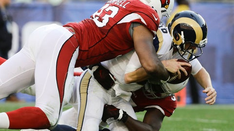 Los Angeles Rams quarterback Jared Goff, center, is sacked by Arizona Cardinals defensive end Calais Campbell, top, and outside linebacker Chandler Jones during the second half of an NFL football game Sunday, Jan. 1, 2017, in Los Angeles. (AP Photo/Jae C. Hong)
