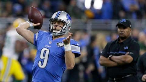 Detroit Lions coach Jim Caldwell, right, watches quarterback Matthew Stafford warm up for the team's NFL football game against the Green Bay Packers, Sunday, Jan. 1, 2017, in Detroit. (AP Photo/Duane Burleson)