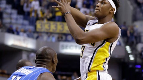 Indiana Pacers center Myles Turner (33) shoots over Orlando Magic center Bismack Biyombo (11) during the second half of an NBA basketball game in Indianapolis, Sunday, Jan. 1, 2017. The Pacers defeated the Magic 117-104. (AP Photo/Michael Conroy)