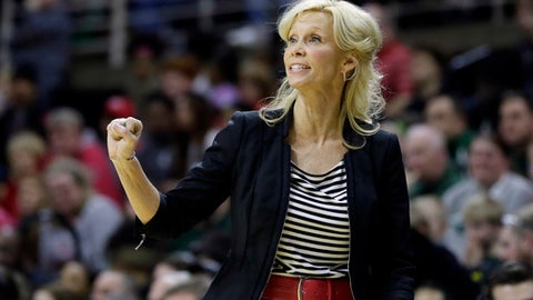 FILE- In this Feb. 27, 2016, file photo, Michigan State head coach Suzy Merchant gestures as she watches from the sidelines during the second half of an NCAA college basketball game against Ohio State in East Lansing, Mich. Merchant fainted while coaching Michigan State against Illinois in a women's basketball game Sunday, Jan. 1, 2017. (AP Photo/Carlos Osorio, File)