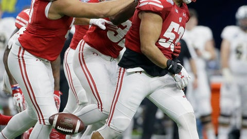 Wisconsin linebacker T.J. Edwards (53) is congratulated by teammates Isaiahh Loudermilk (97) and Leon Jacobs (32) after catching an interception during the fourth quarter against Western Michigan in the Cotton Bowl NCAA college football game Monday, Jan. 2, 2017, in Arlington, Texas. (AP Photo/LM Otero)