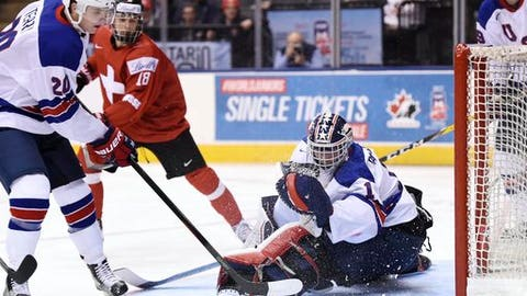 United States forward Troy Terry (20) clears the puck after a save by goaltender Tyler Parsons (1) against Switzerland during the second period of a quarterfinal hockey game at the world junior championship in Toronto, Monday, Jan. 2, 2017. (Frank Gunn/The Canadian Press via AP)