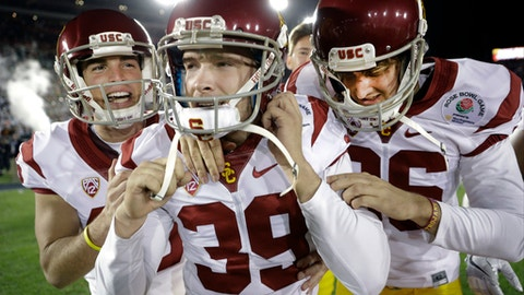 Southern California place kicker Matt Boermeester, middle, celebrates after the game winning field goal against Penn State during the second half of the Rose Bowl NCAA college football game Monday, Jan. 2, 2017, in Pasadena, Calif. (AP Photo/Jae C. Hong)