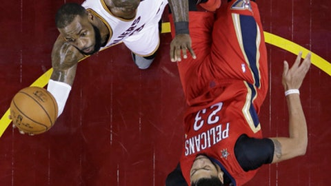 Cleveland Cavaliers' LeBron James, left, is called for an offensive foul against New Orleans Pelicans' Anthony Davis in the first half of an NBA basketball game, Monday, Jan. 2, 2017, in Cleveland. (AP Photo/Tony Dejak)