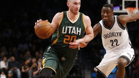 Utah Jazz forward Gordon Hayward (20) drives pas Brooklyn Nets' guard Caris LeVert (22) in the second half of an NBA basketball game, Monday, Jan. 2, 2017, in New York. Hayward scored 30 points as the Jazz defeated the Nets 101-89. (AP Photo/Kathy Willens)