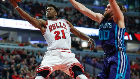 Chicago Bulls forward Jimmy Butler (21) goes to the basket against Charlotte Hornets forward Spencer Hawes during the second half of an NBA basketball game, Monday, Jan. 2, 2017, in Chicago. (AP Photo/Kamil Krzaczynski)