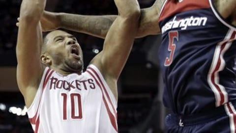 Houston Rockets' Eric Gordon (10) is fouled by Washington Wizards' Markieff Morris (5) during the second half of an NBA basketball game Monday, Jan. 2, 2017, in Houston. The Rockets won 101-91. (AP Photo/David J. Phillip)