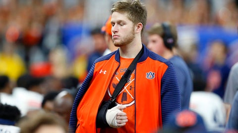 Auburn quarterback Sean White walks on the sideline with his arm in a cast and sling in the second half of the Sugar Bowl NCAA college football game against Oklahoma in New Orleans, Monday, Jan. 2, 2017. (AP Photo/Butch Dill)
