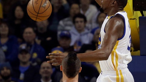 Golden State Warriors' Kevin Durant, right, scores over Denver Nuggets' Danilo Gallinari (8) during the first half of an NBA basketball game Monday, Jan. 2, 2017, in Oakland, Calif. (AP Photo/Ben Margot)