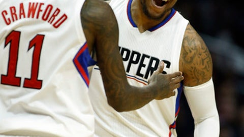 Los Angeles Clippers center Marreese Speights, right, reacts after making a three-point shot with guard Jamal Crawford (11) during the first half of an NBA basketball game against the Phoenix Suns in Los Angeles, Monday, Jan. 2, 2017. (AP Photo/Alex Gallardo)