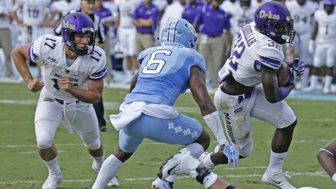 North Carolina's M.J. Stewart (6) chases as James Madison's Khalid Abdullah (32) takes a handoff from quarterback Bryan Schor in the first half of an NCAA college football game in Chapel Hill, N.C., Saturday, Sept. 17, 2016. Abdullah scored on the play. (AP Photo/Gerry Broome)