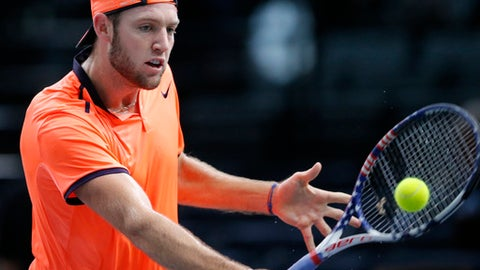 Jack Sock of the United States returns the ball to John Isner of the United States in the quarterfinal match of the Paris Masters tennis tournament at the Bercy Arena in Paris, Friday, Nov. 4, 2016. (AP Photo/Michel Euler)