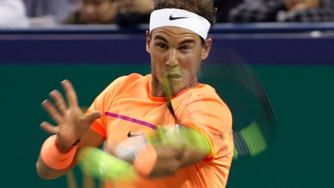 Rafael Nadal of Spain hits a return shot against Viktor Troicki of Serbia during the men's singles match of the Shanghai Masters tennis tournament at Qizhong Forest Sports City Tennis Center in Shanghai, China, Wednesday, Oct. 12, 2016. (AP Photo/Andy Wong)