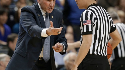 FILE - In this Dec. 21, 2016, file photo,Duke head coach Mike Krzyzewski, left, argues a call with an official in the second half of an NCAA college basketball game against Elon in Greensboro, N.C. Krzyzewski has lamented this has been a season of interruptions so far for No. 8 Duke. The latest one has to do with Coach K himself, after the Hall of Famer announced he will step away from the team later this week to have back surgery.  (AP Photo/Chuck Burton, File)