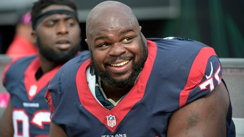 """FILE - In this Oct. 18, 2015, file photo, Houston Texans nose tackle Vince Wilfork (75) watches from the bench during the second half an NFL football game against the Jacksonville Jaguars in Jacksonville, Fla. Wilfork is considering retirement after this season. The 35-year-old Wilfork says: """"I've been thinking about it. I'm not saying I will do it, and I'm not saying that I won't do it. But it's definitely not off the table."""" (AP Photo/Phelan M. Ebenhack, File)"""