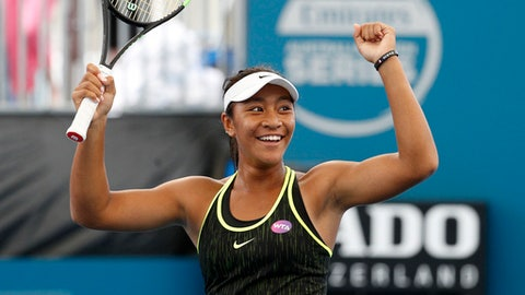 In this Jan. 3, 2017, photo Australia's Destanee Aiava celebrates after winning her first round match against Bethanie Mattek-Sands of the USA at the Brisbane International Tennis Tournament in Brisbane, Australia.  The 16-year-old Aiava advanced through qualifying before becoming the first player born in the 2000s to win a main draw match at an elite WTA event, beating veteran American Mattek-Sands 2-6, 6-3, 6-4. (Dave Hunt/AAP Image VIA AP) NO ARCHIVING, EDITORIAL USE ONLY, AUSTRALIA OUT, NEW ZEALAND OUT, PAPUA NEW GUINEA OUT, SOUTH PACIFIC OUT