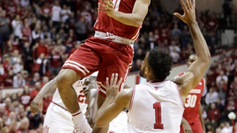 Wisconsin's D'Mitrik Trice puts up a shot against Indiana's James Blackmon Jr. during the first half of an NCAA college basketball game Tuesday, Jan. 3, 2017, in Bloomington Ind. (AP Photo/Darron Cummings)