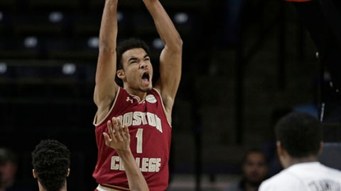 Boston College's Jerome Robinson (1) reacts to his dunks over Wake Forest's John Collins (20) in the first half of an NCAA college basketball in Winston-Salem, N.C., Tuesday, Jan. 3, 2017. (AP Photo/Chuck Burton)