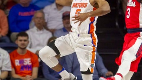Florida guard KeVaughn Allen (5) tries to save the ball from going out of bounds as Mississippi guard Terence Davis (3) defends during the first half of an NCAA college basketball game in Gainesville, Fla., on Tuesday, Jan. 3, 2017. (AP Photo/Ron Irby)