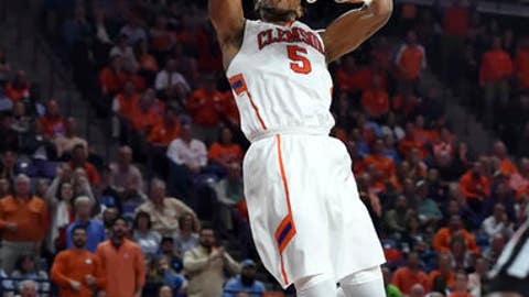 Clemson's Jaron Blossomgame slams in a dunk during the first half of an NCAA college basketball game against North Carolina Tuesday, Jan. 3, 2017, in Clemson, S.C. (AP Photo/Richard Shiro)