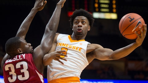 Tennessee's Robert Hubbs III (3) attempts a shot past Arkansas' Moses Kingsley (33) during the first half of an NCAA college basketball game in Knoxville, Tenn., Tuesday, Jan. 3, 2017. (Brianna Paciorka/Knoxville News Sentinel via AP)