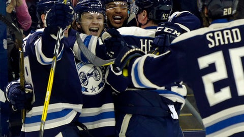 Columbus Blue Jackets forward Boone Jenner, left, forward William Karlsson, of Sweden, defenseman Seth Jones, forward Scott Hartnell and forward Brandon Saad celebrate Karlsson's goal against the Edmonton Oilers during the second period of an NHL hockey game in Columbus, Ohio, Tuesday, Jan. 3, 2017. The Blue Jackets won 3-1. (AP Photo/Paul Vernon)