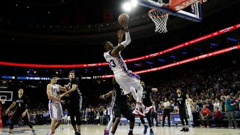 Philadelphia 76ers' Robert Covington scores the go-ahead basket in the final seconds of an NBA basketball game against the Minnesota Timberwolves, Tuesday, Jan. 3, 2017, in Philadelphia. Philadelphia won 93-91. (AP Photo/Matt Slocum)