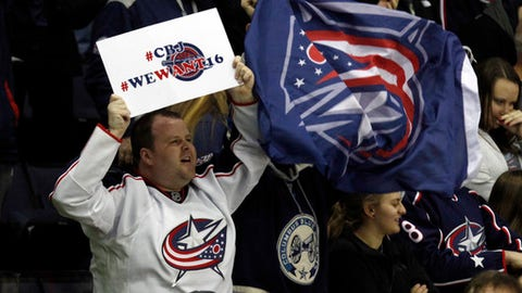 Columbus Blue Jackets fans cheer during the during the third period of an NHL hockey game against the Edmonton Oilers in Columbus, Ohio, Tuesday, Jan. 3, 2017. The Blue Jackets won 3-1 extending the team's winning streak to 16 games. (AP Photo/Paul Vernon)