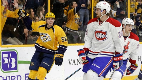Nashville Predators left wing Kevin Fiala (56), of Switzerland, celebrates after scoring a goal against the Montreal Canadiens during the second period of an NHL hockey game Tuesday, Jan. 3, 2017, in Nashville, Tenn. At right are Canadiens defenseman Jeff Petry (26) and defenseman Nathan Beaulieu (28). (AP Photo/Mark Humphrey)