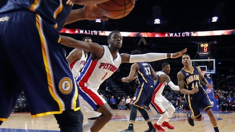 Detroit Pistons guard Reggie Jackson (1) blocks Indiana Pacers guard Glenn Robinson III (40) from a clear throw in to teammate Jeff Teague (44) during the second half of an NBA basketball game, Tuesday, Jan. 3, 2017, in Auburn Hills, Mich. (AP Photo/Carlos Osorio)