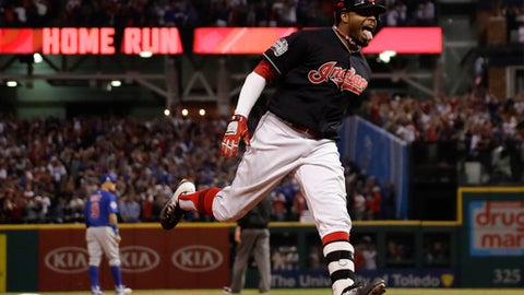 This Nov. 2, 2016 file photo shows Cleveland Indians' Rajai Davis celebrating after his two-run home run against the Chicago Cubs during the eighth inning of Game 7 of the Major League Baseball World Series in Cleveland. After a World Series trip with Cleveland, Davis is returning to the Bay Area with the Oakland Athletics on a $6 million, one-year contract to fill a void in center field. (AP Photo/Matt Slocum, file)