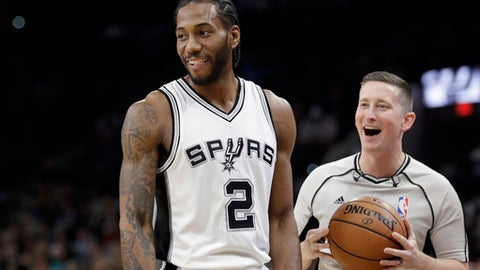 San Antonio Spurs forward Kawhi Leonard (2) and referee Nick Buchert (3) share a laugh during the first half of an NBA basketball game against the Toronto Raptors, Tuesday, Jan. 3, 2017, in San Antonio. (AP Photo/Eric Gay)
