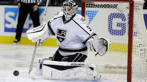 Los Angeles Kings goalie Peter Budaj eyes a shot from the San Jose Sharks during the third period of an NHL hockey game Tuesday, Jan 3, 2017, in San Jose, Calif. The Kings won 2-1 in overtime. (AP Photo/Ben Margot)