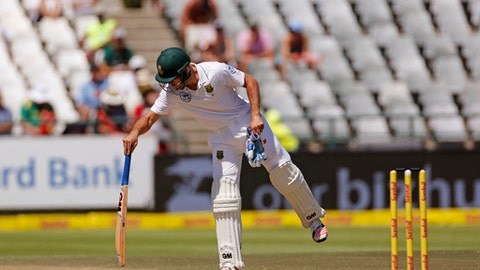 South African Stephen Cook plays test the pitch with his bat during the 2nd test cricket match between South Africa and Sri Lanka, in Cape Town, South Africa, Wednesday, Jan. 4, 2017. (AP Photo/Schalk van Zuydam)
