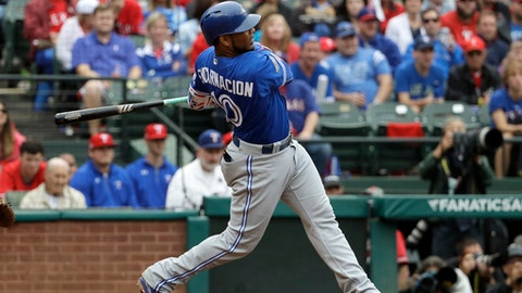 FILE - In this Oct. 7, 2016, file photo, Toronto Blue Jays' Edwin Encarnacion hits a solo home run off of Texas Rangers' Yu Darvish in the fifth inning of Game 2 of baseball's American League Division Series in Arlington, Texas. The free agent slugger is undergoing a medical evaluation, the final step before he officially signs with the Cleveland Indians. Encarnacion agreed to terms on a three-year, $65 million contract with the AL champions before Christmas. Barring any unforeseen physical issues, the deal should be finalized Wednesday, Jan. 4, 2017, and the Indians will welcome him at a news conference on Thursday.  (AP Photo/David J. Phillip, File)