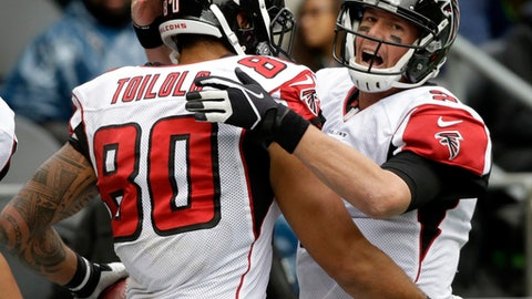 FILE - In this Oct. 16, 2016, file photo, Atlanta Falcons quarterback Matt Ryan (2) celebrates with tight end Levine Toilolo (80) after connecting for a touchdown in the second half of an NFL football game in Seattle. The Falcons have never had an MVP. That might be about to change. Ryan had the best season of his career, and it could be enough to earn him the league's top individual award.  (AP Photo/Elaine Thompson, File)