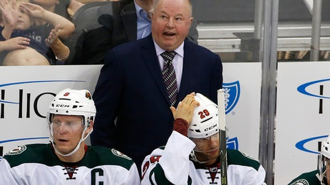 FILE - In this Nov. 10, 2016, file photo, Minnesota Wild head coach Bruce Boudreau talks with a linesman during the third period of an NHL hockey game against the Pittsburgh Penguins in Pittsburgh. Their 12-game winning streak over, the Wild are trying to stay in form as they embark on a three-game West Coast road trip. For coach Boudreau's part, they've been scoring a little too much. He'd feel a lot better with 2-1 wins than 6-4 victories(AP Photo/Gene J. Puskar, File)