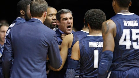 Villanova head coach Jay Wright is restrained by playes after receiving a technical foul in the first half of an NCAA college basketball game against the Butler in Indianapolis, Wednesday, Jan. 4, 2017. (AP Photo/Michael Conroy)