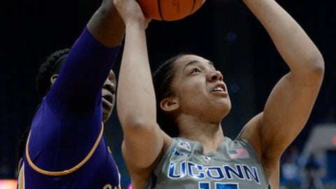 Connecticut's Gabby Williams looks to shoot as East Carolina's GabrielleHolston, left, defends, in the first half of an NCAA college basketball game, Wednesday, Jan. 4, 2017, in Hartford, Conn. (AP Photo/Jessica Hill)
