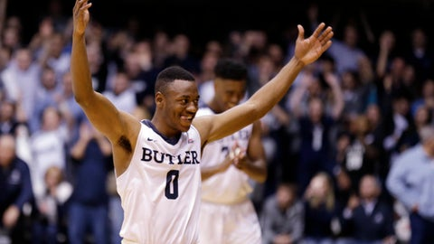 Butler guard Avery Woodson (0) celebrate in the closing seconds of the of the second half of an NCAA college basketball game against the Villanova in Indianapolis, Wednesday, Jan. 4, 2017. Butler defeated Villanova 66-58. (AP Photo/Michael Conroy)